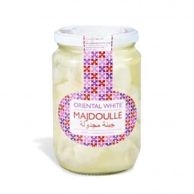 Produktbild på Oriental White majdoulle i en glasburk.